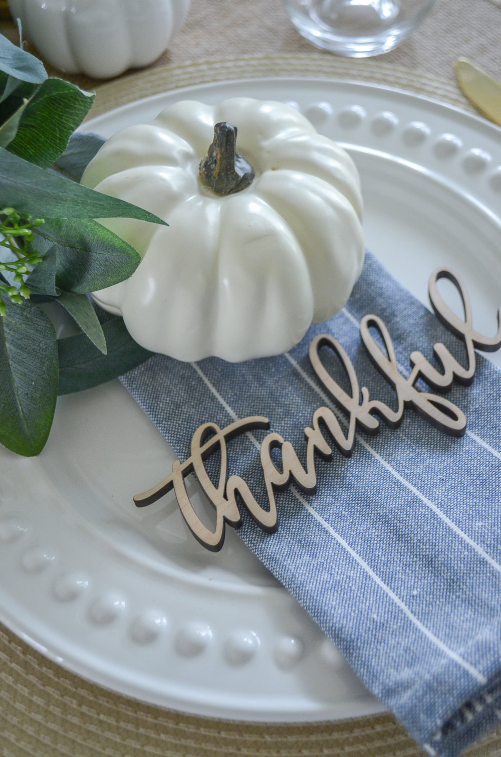 Easy farmhouse style Thanksgiving place setting with wood cut outs.