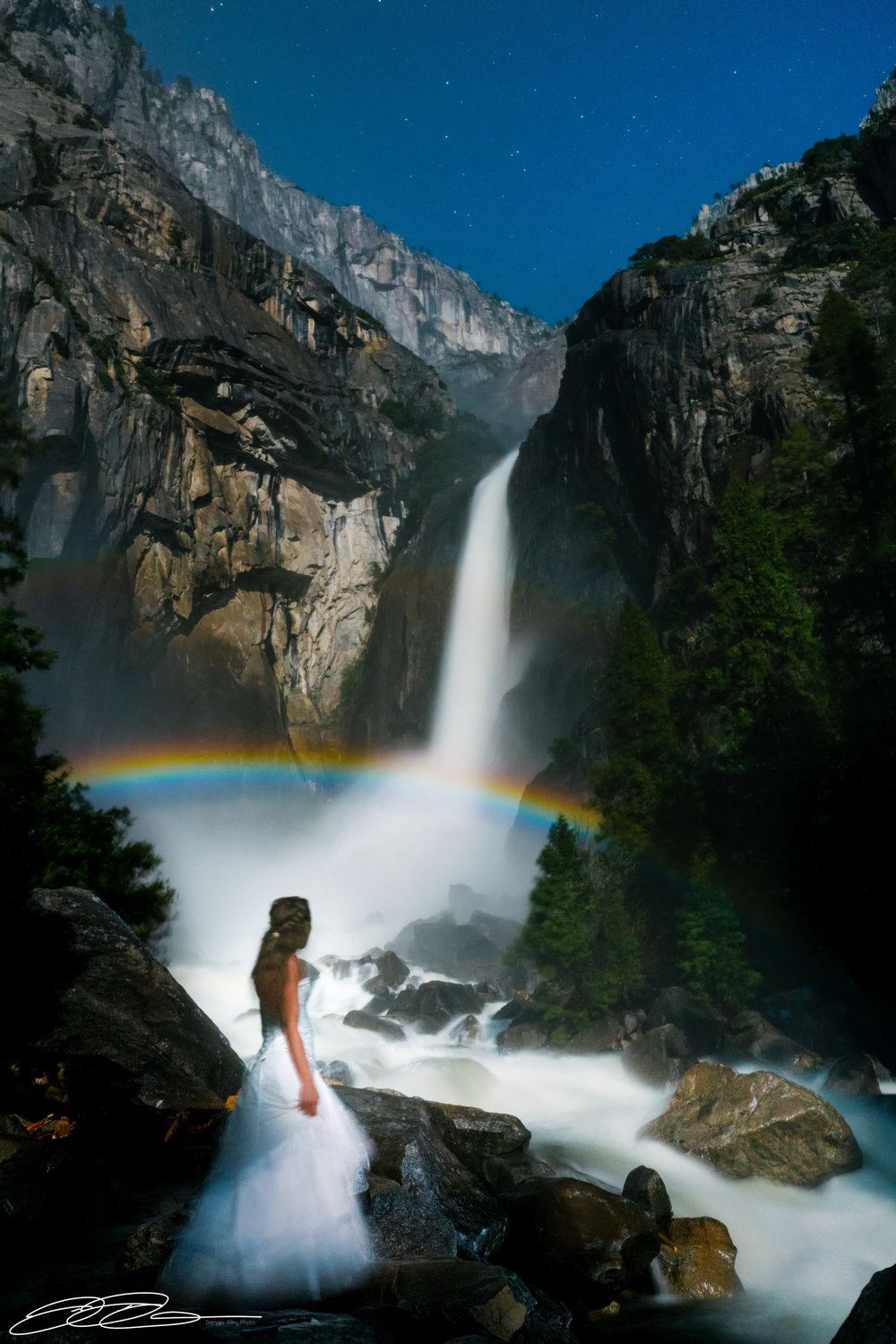 Yosemite Moonbowonly available when water conditions support and on a full moon - Captured with a bride in wedding gown.