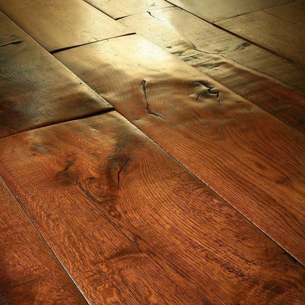 1 rich foot worn instead of reclaimed flooring.jpg