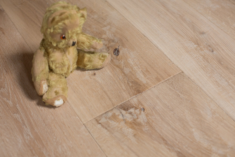 Wide plank distressed wood flooring