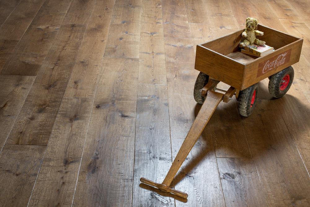 Distressed engineered flooring