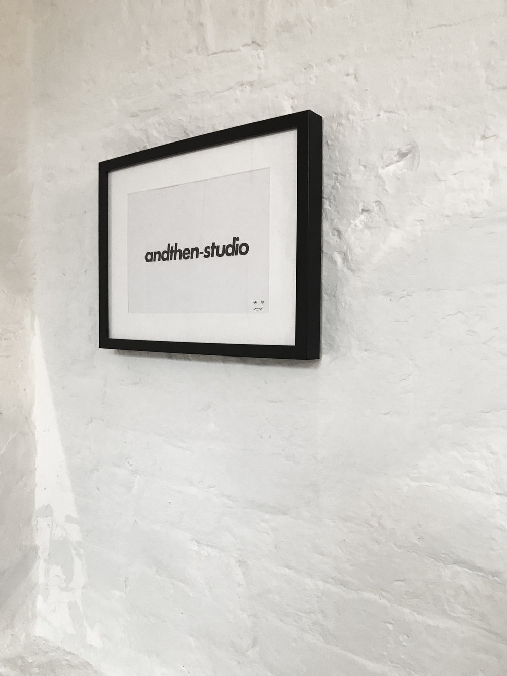 andthen-studio logo on the wall