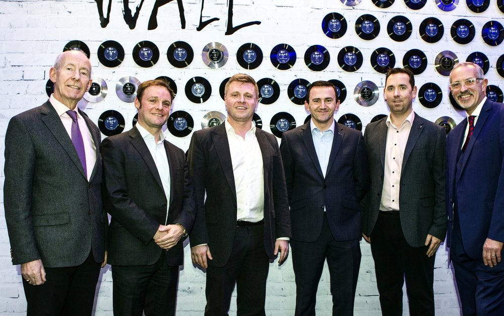 L-R: Conal Harvey (executive vice chairman of Harcourt Developments), Nick Doherty (group finance director of Harcourt Developments), John Paul Doherty (creative director of Harcourt Developments), Gerry Comasky (group property manager of Harcourt Developments), Padraig Power (project manager of Harcourt Developments), Tim Husbands MBE (Chief Executive of operator TBL International) all in front of our wall of fame.