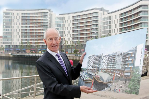 Pictured with an original CGI of Titanic Quarter's ARC Residential Complex in front of the completed development is Conal Harvey, Titanic Quarter's Executive Vice Chairman