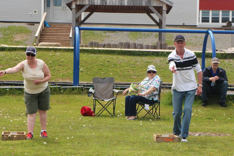 Flo Russell and John L. MacDonald warming up for the washer toss event. - Richard MacKenzie