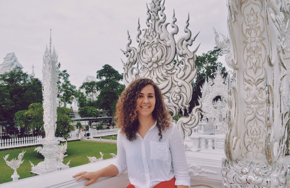 Lauren at Wat Rong Khun, more commonly known as the White Temple, in Chiang Rai, Thailand