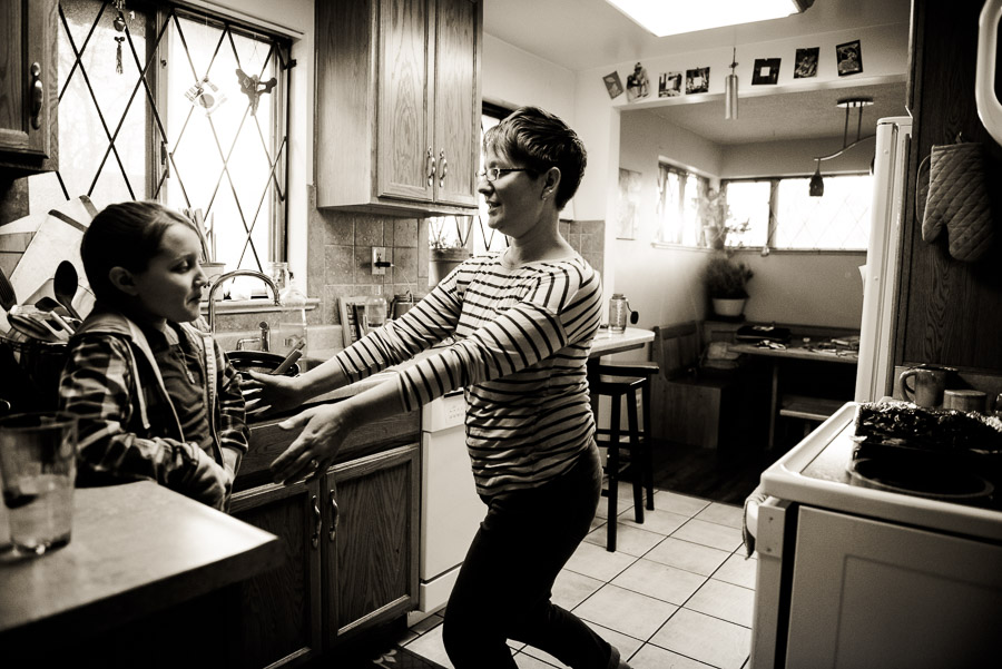 day in the life family photogrphy - mom tickles in kitchen
