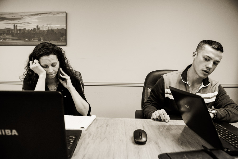 Lawyer and her client both on phone looking frustrated.