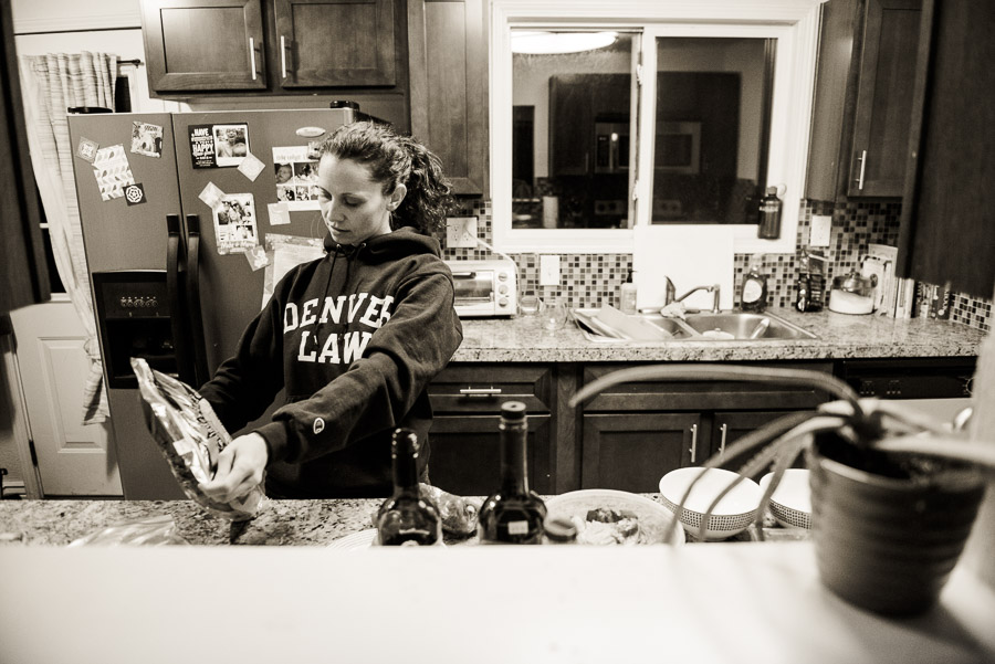 Preparing dinner in her Denver Law sweatshirt.
