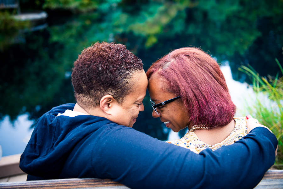 High school senior and her mom press their foreheads together