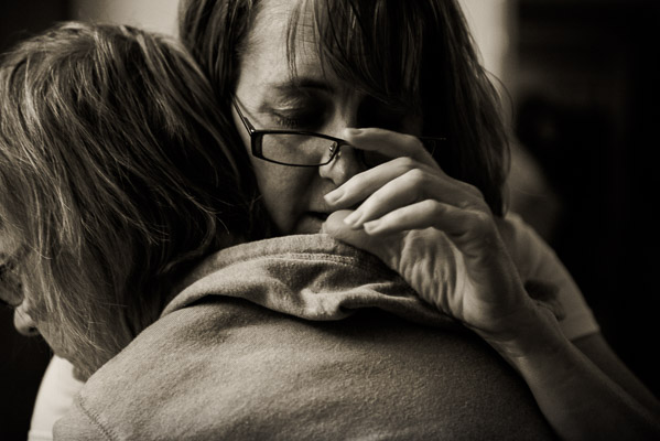 Touching photo of woman huggin and older woman.