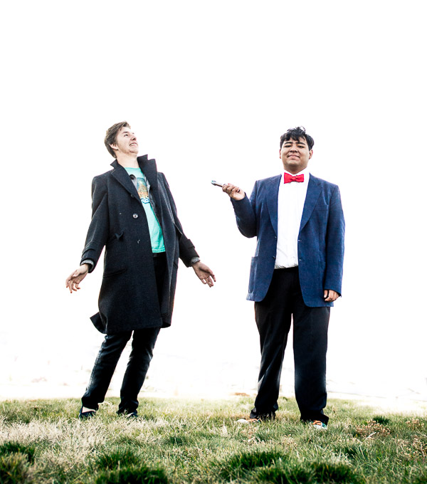 Two high school senior boys mimicing Dr. Who on top of a hill.
