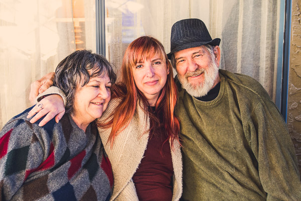 Celebrating Dad Photos man and two women posing for a picture.
