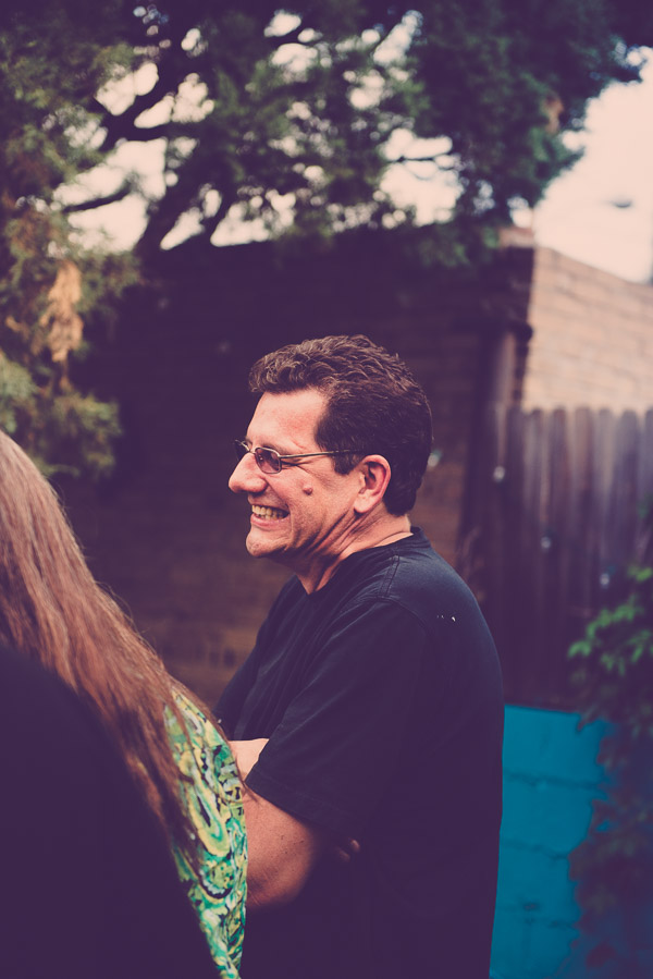 Side view of a man laughing.