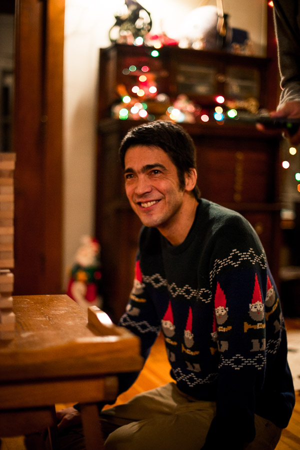 Smiling man in a Christmas gnome ugly sweater.