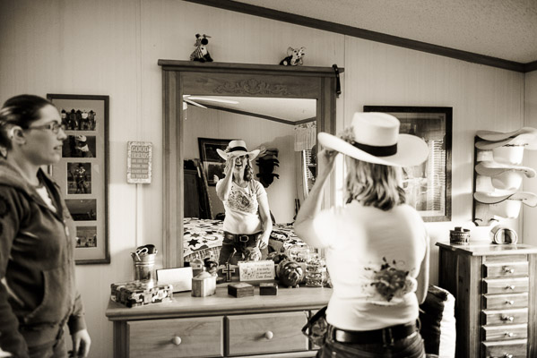 Woman in cute cowboy hat looking in mirror