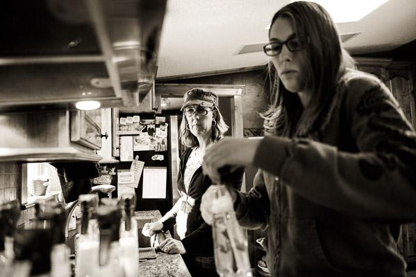 Two women filling bottles.