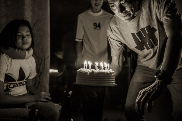 Black and white of a group with birthday candles