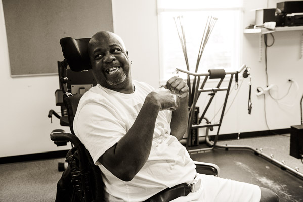 A man in a wheelchair laughing.