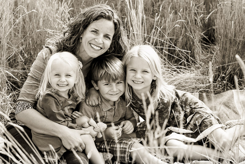 Black and white fall family photos in Carbondale mom with three kids.
