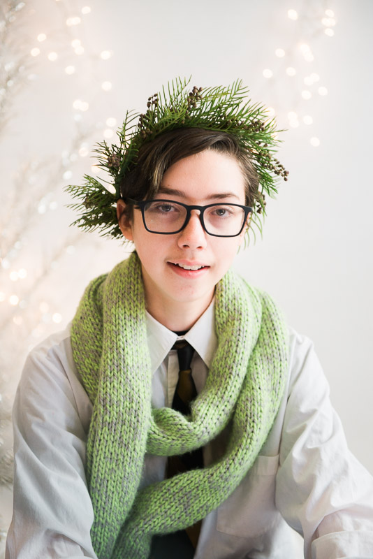 studio session boy wearing christmas crown and scarf