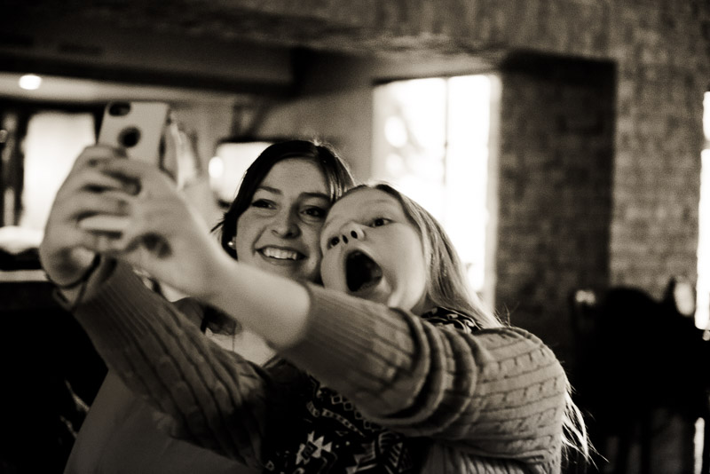 Two girls taking a selfie.