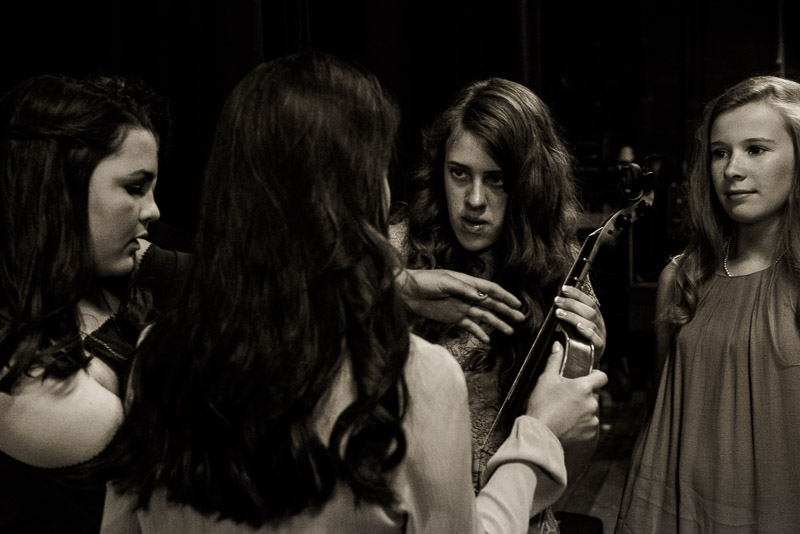 students preparing for a performance
