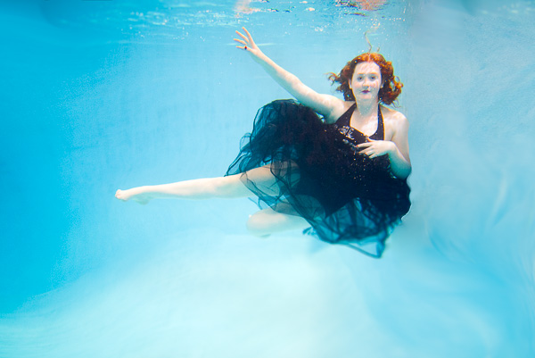 High school senior photo underwater.