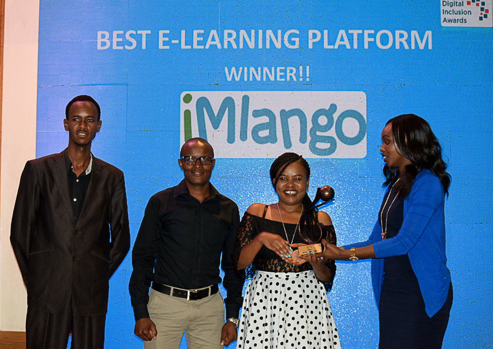 Anthony Kogi, Ernest Dishon and   Wambui Maina from sQuid Kenya collect the award on behalf of the programme.