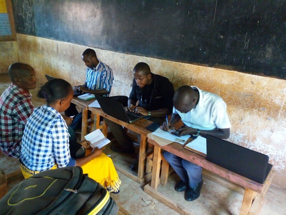 The team process one of the first Microloan applications in Makueni County