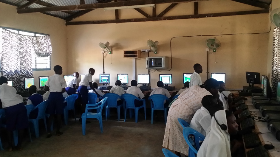 An iMlango literacy computer lab lesson in progress. Students have access to digital content for both individual lab sessions and teacher-guided whole-class lessons.