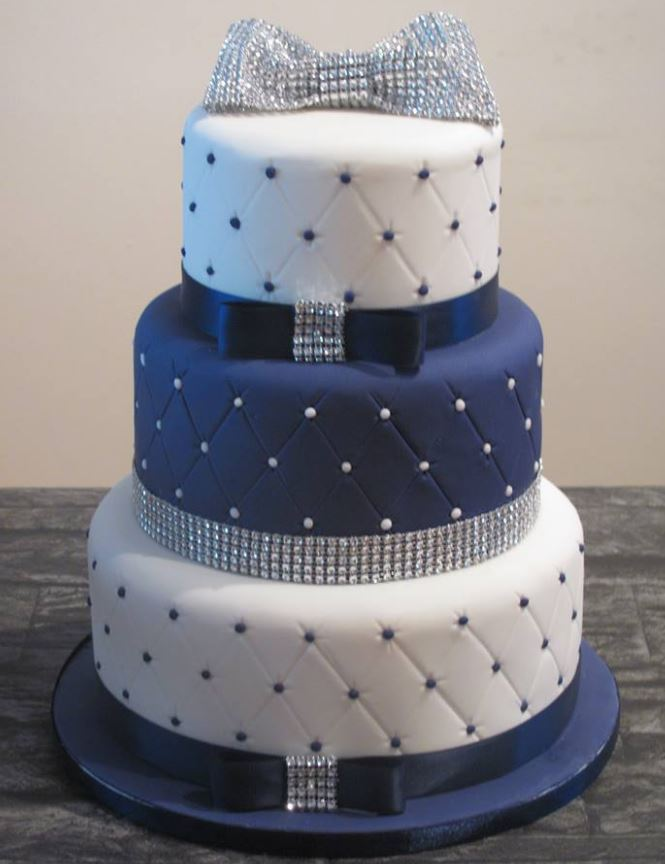 Navy and white three tier quilted wedding cake with diamonte trim