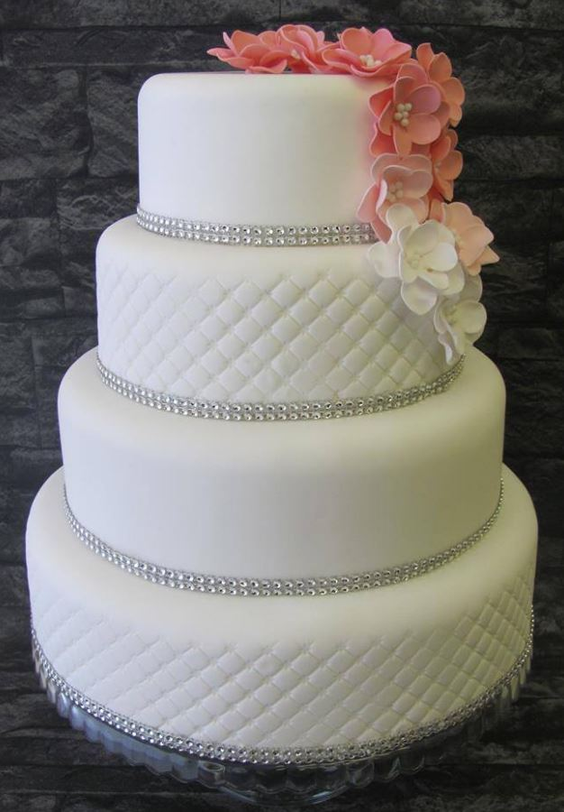 Four tier wedding cake with diamonte trim and edible fondant flowers