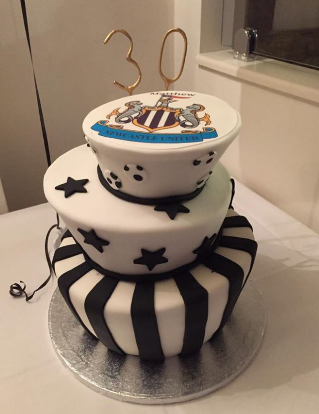 Topsy turvy newcastle toon cake
