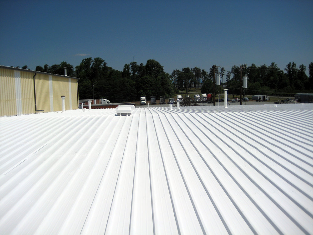 Overview-After-White-Acryic-Elastomeric-Coating-Spray-Applied-to-Metal-Roof-in-Winston-Salem-NC.jpg