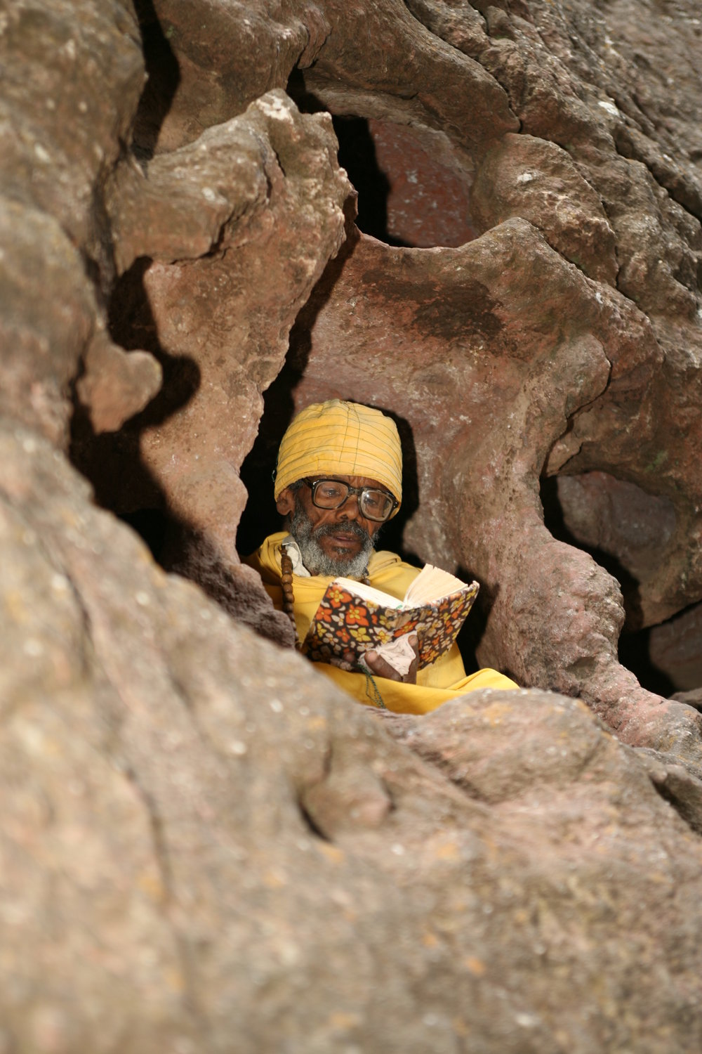 a monk at one of the church window in Lalibela.jpg