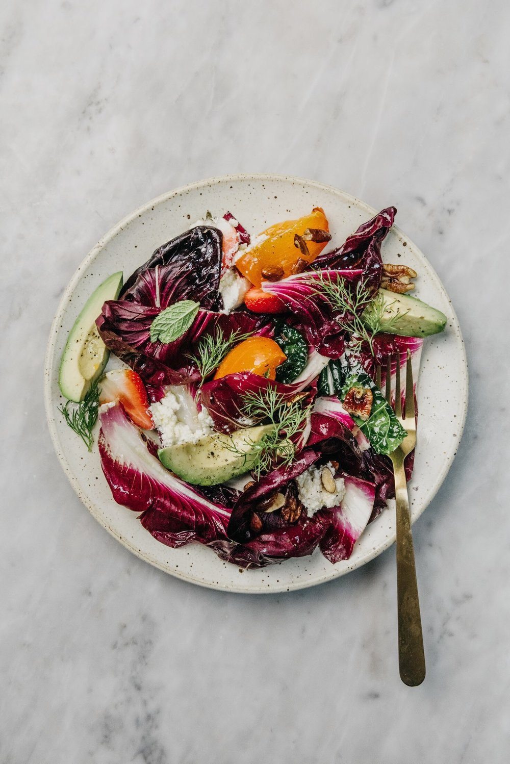 WINTER GREENS AND PERSIMMON SALAD WITH RICOTTA AND AVOCADO by Sarah Copeland #healthyeating #healthyrecipes #cleaneating #persimmon #avocado #sarahcopeland #edibleliving #raddichio #foodstyling #foodphotography #harrisonlubin
