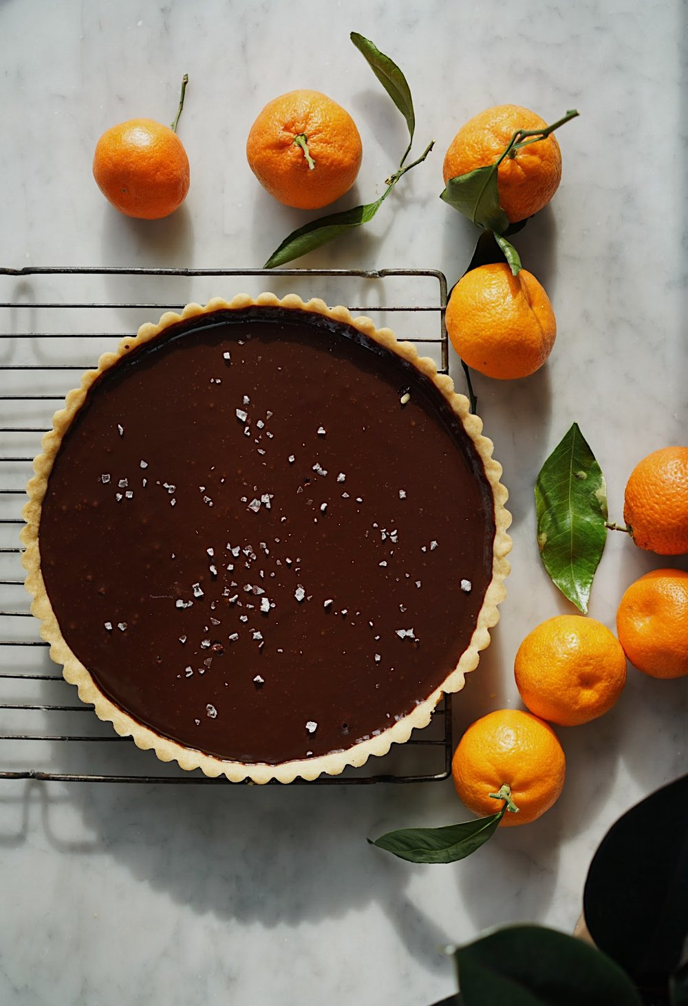BITTERSWEET CHOCOLATE TART WITH SEA SALT  by Sarah Copeland #chocolate #bittersweetchocolate #chocolaterecipes #chocolatetruffle #sarahcopeland #edibleliving