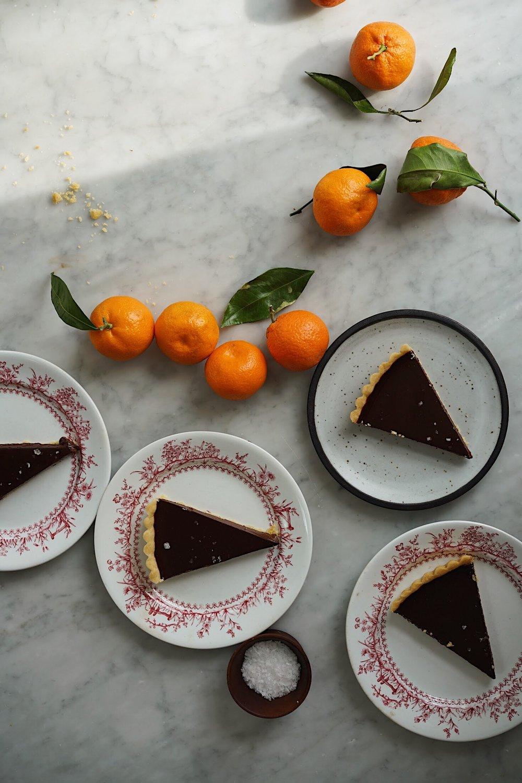 BITTERSWEET CHOCOLATE TART WITH SEA SALT  by Sarah Copeland #chocolate #bittersweetchocolate #chocolaterecipes #chocolatetruffle #sarahcopeland #edibleliving
