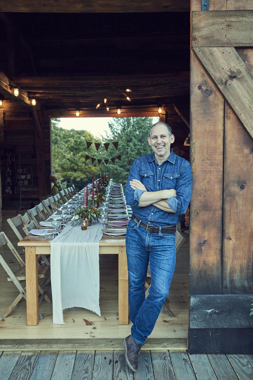 Furniture Designer ANDRAS GIPP of Hudson Workshop in front of his 26-foot maple table built for RAVENWOOD (UPSTATE, NY)   #designbyAndrasgipp #Hudsonworkshop #ravenwood #barnparty #partybarn #dinnerparty