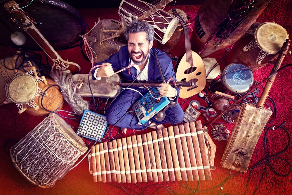 HAT              (NY / Morocco) - In his one-of-a-kind live show, HAT is as an orchestra conductor from the future, beaming traditional musicians from the four corners of the world onto a big screen...