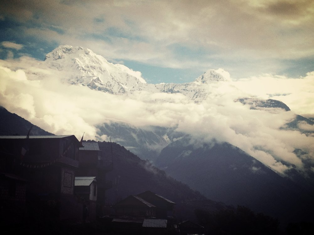 Ghandruk village with Annapurna's South, standing 7,209m tal and the Hiunchuli poking its head from within the monsoon clouds.