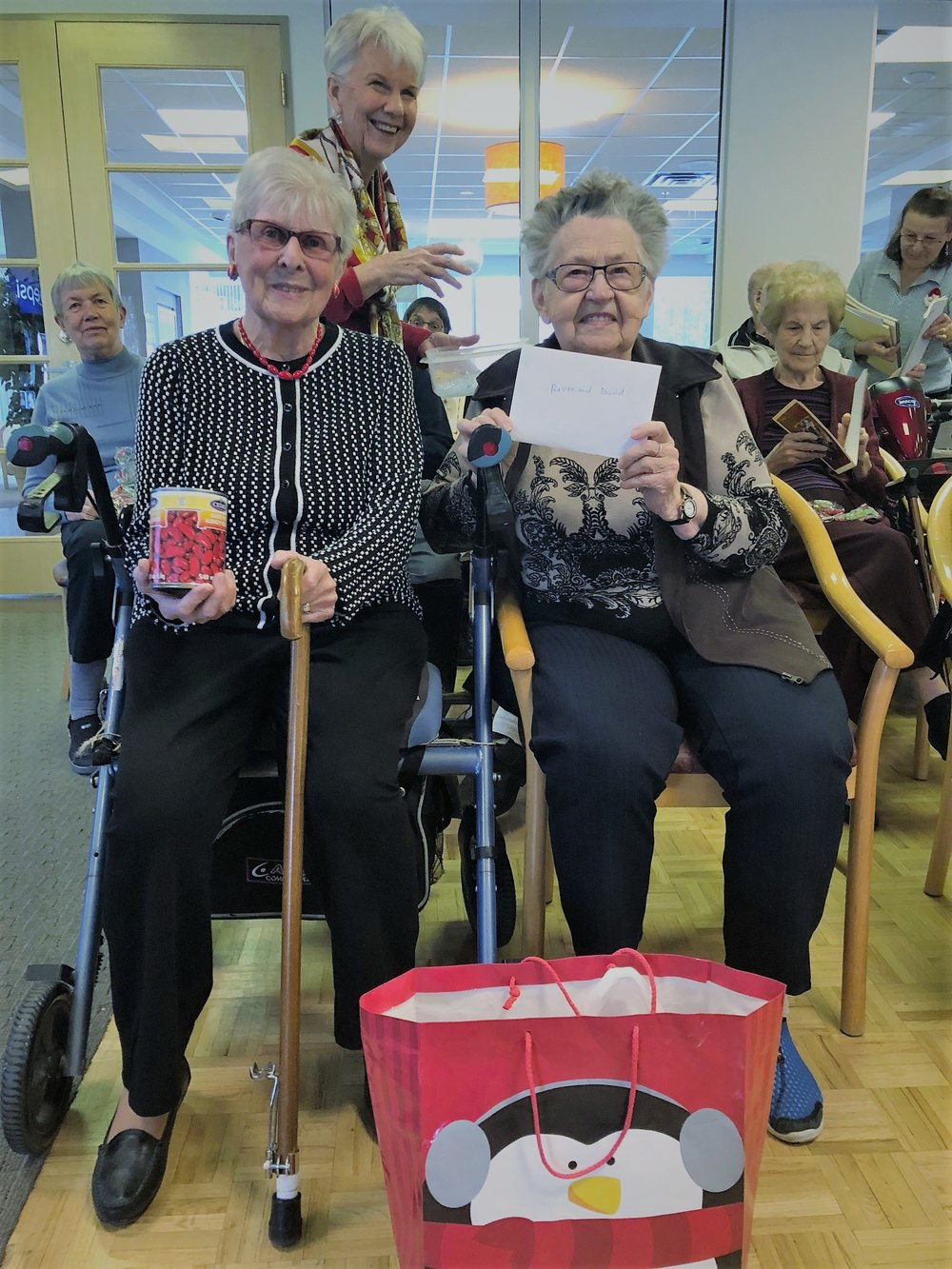 Eileen and Yvette from Les Floralies, LaSalle gave monies and canned goods for families in need at Christmas on behalf of the residents.