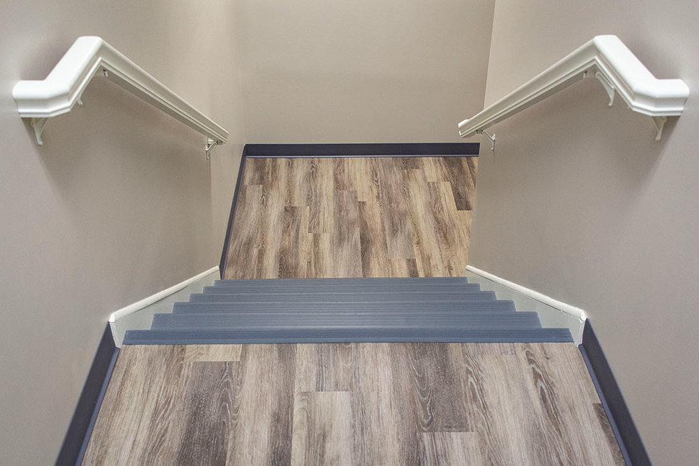 IMG_8645-web-landing-lvp-vinyl-plank-wood-stairs-vinyl-treads-risers-new-holland-transport-september-2018-dandsflooring.jpg