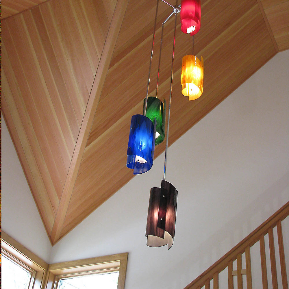 Mixed color Vortex chandelier in stair well.jpg