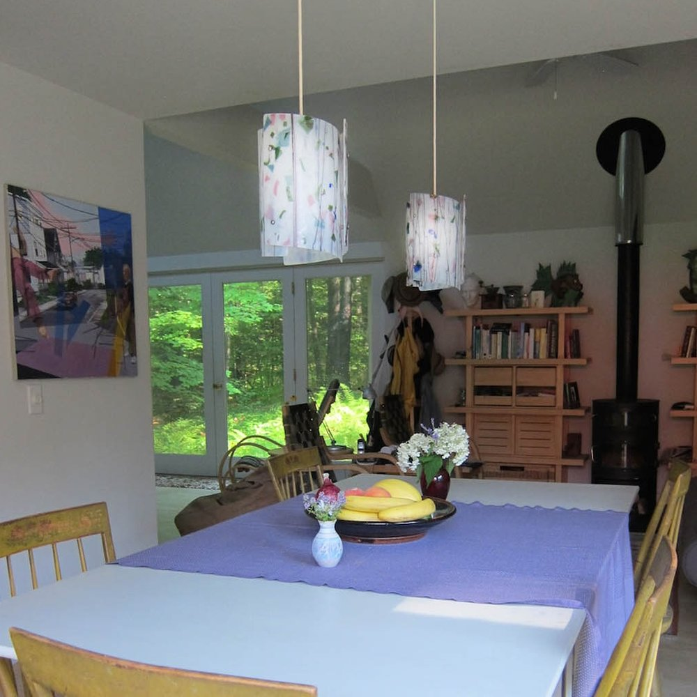 A pair of Sushi pendants in dining room.jpg