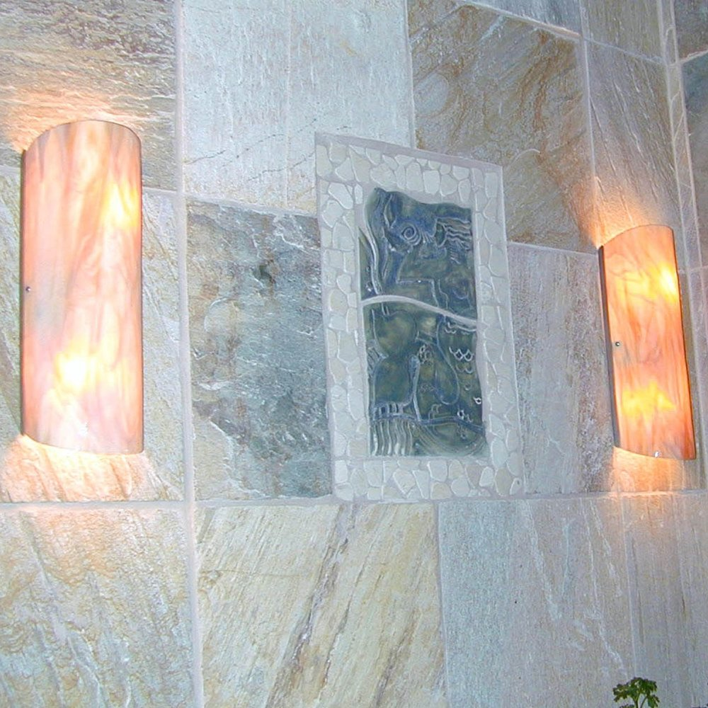 Ceres II sconces in medium amber glass.jpg