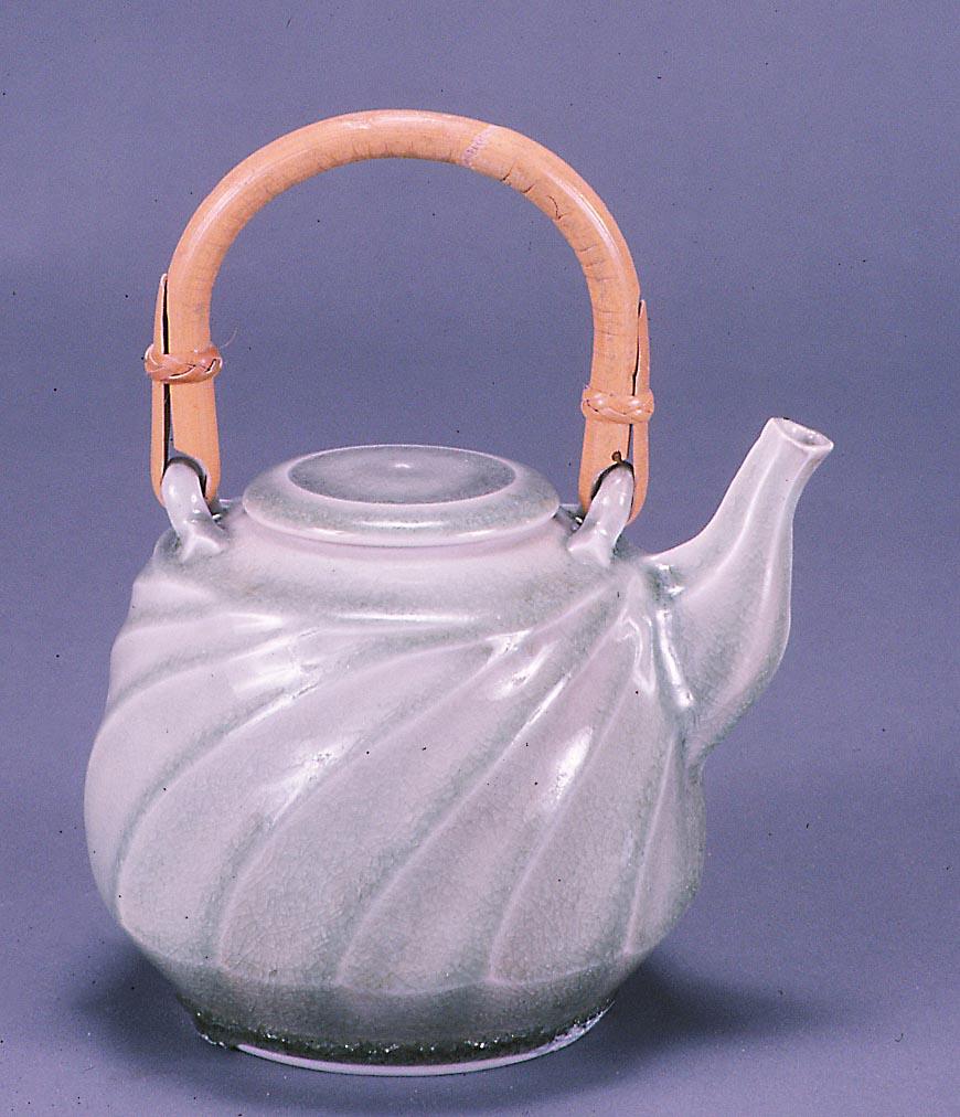 Carved porcelain teapot, celadon glaze
