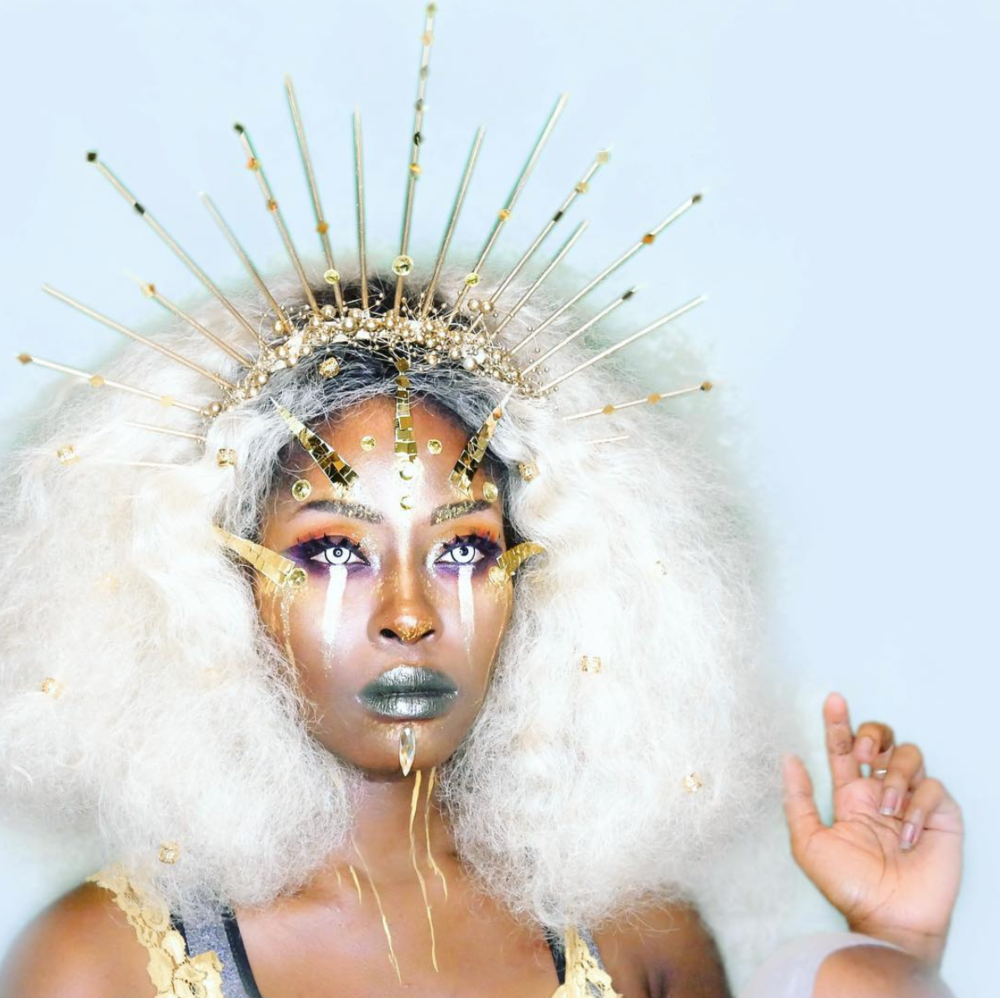 Sun Goddess - Phillicia Deanell's look is 100% at the center of our universe. She uploads tons of costume makeup tutorials on Youtube so you can glow up any time of the year.