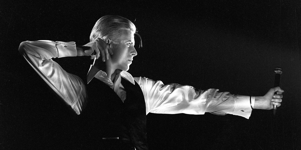 """The Archer,"" one of David Bowie's own all-time favourite photographs of himself, was taken at Toronto's Maple Leaf Gardens in 1976. Photo by John Robert Rowlands"